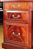 This close up highlights the crotch and ribbon stripe mahogany veneers  used in the drawer fronts.