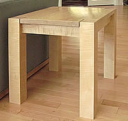 Contemporary End Table, one of a series, maple with a clear lacquer finish.